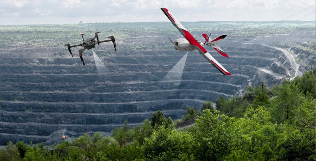 Drones flying over a mine